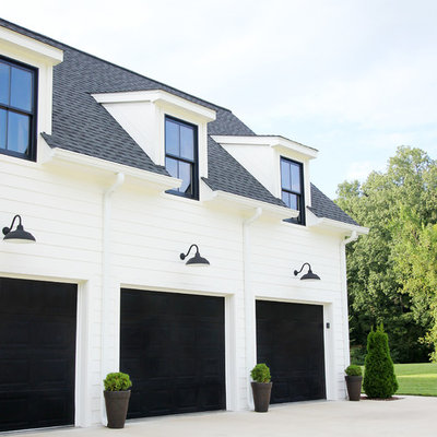 Mid-sized country white two-story concrete fiberboard exterior home idea in Other with a mixed material roof