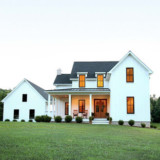 Example of a farmhouse white two-story concrete fiberboard exterior home design in Other with a shingle roof