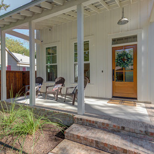 Mid-sized cottage white two-story wood house exterior idea in Austin