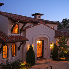 Mediterranean Exterior by Landmark Builders