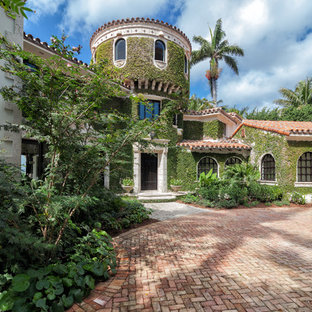 Inspiration for a huge mediterranean exterior home remodel in Miami