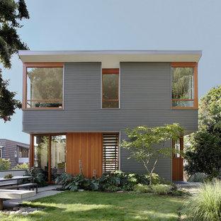 Idee per la villa multicolore contemporanea a due piani di medie dimensioni con rivestimenti misti e tetto piano