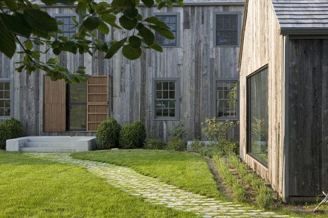 Farmhouse Exterior by d'apostrophe design, inc.