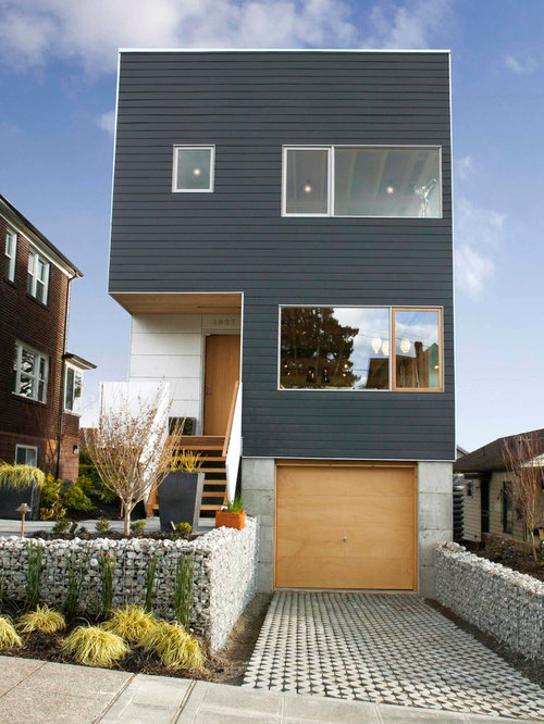 Inspiration For A Contemporary Black Three Story Flat Roof Remodel In  Seattle