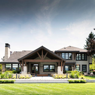 Inspiration for a large rustic two-story wood exterior home remodel in Vancouver with a hip roof