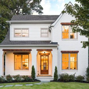 Foto de fachada de casa blanca, tradicional renovada, de tamaño medio, de dos plantas, con tejado a dos aguas, tejado de teja de madera y revestimiento de ladrillo