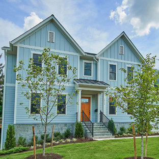 Inspiration for a large transitional grey house exterior in DC Metro with three or more storeys, concrete fiberboard siding, a gable roof and a shingle roof.