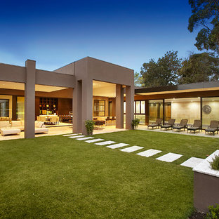 Inspiration for a contemporary brown one-story exterior home remodel in Melbourne