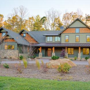 Ejemplo de fachada de casa verde, campestre, grande, de dos plantas, con tejado a dos aguas, tejado de teja de madera y revestimientos combinados