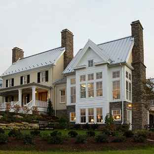 Large traditional beige two-story mixed siding exterior home idea in Richmond with a metal roof