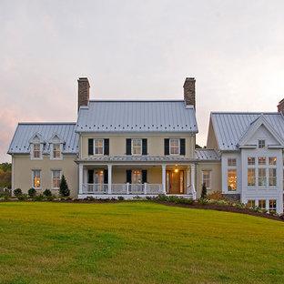 Idéer för stora vintage beige hus, med två våningar och blandad fasad