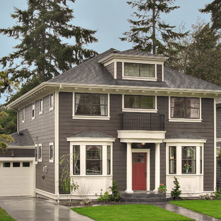 Mid-sized traditional three-story wood exterior home idea in Seattle