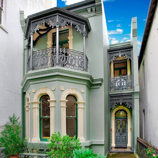 Ornate green two-story exterior home photo in Sydney