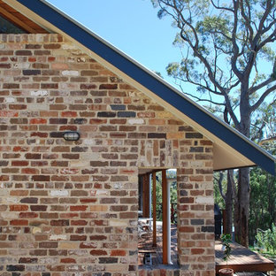 Mountain style brick exterior home photo in Sydney