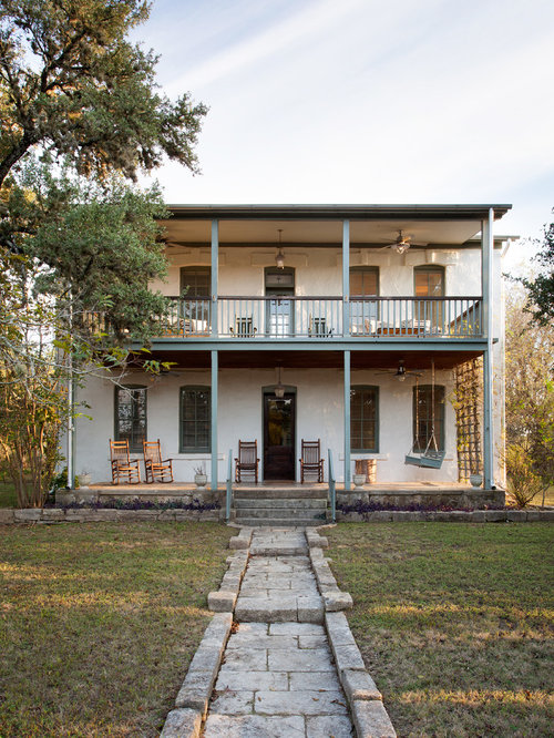 Mid Sized Country White Two Story Stucco Exterior Home Photo In Austin With  A