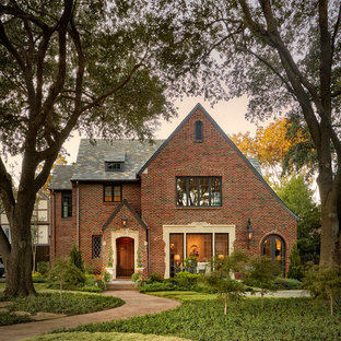 Example of a large classic red three-story brick exterior home design in Dallas with a shingle roof