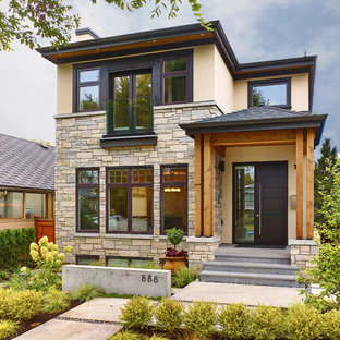 Inspiration for a small transitional two-story mixed siding house exterior remodel in Vancouver