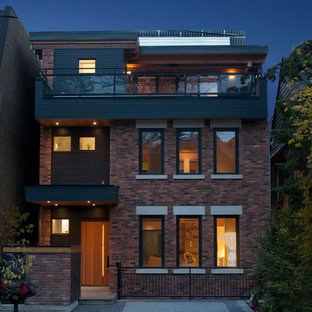 Mid-sized eclectic three-story brick flat roof idea in Toronto