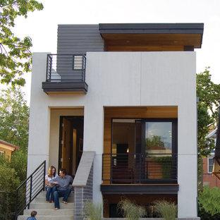 Ispirazione per la facciata di una casa bianca moderna a tre o più piani di medie dimensioni con rivestimento con lastre in cemento