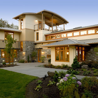 Contemporary stone exterior home idea in Portland with a metal roof