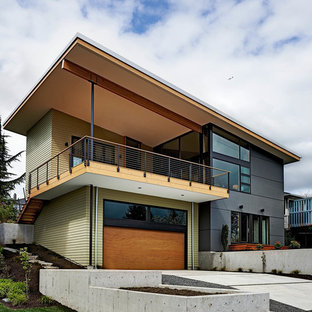 Example of a trendy two-story mixed siding exterior home design in Seattle