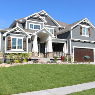 Example of a large arts and crafts gray two-story stucco exterior home design in Kansas City with a shingle roof