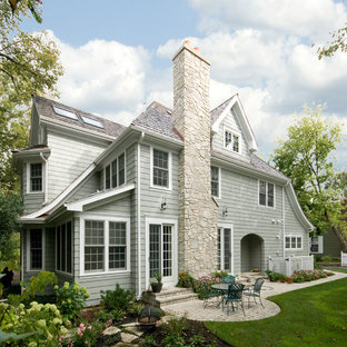 Mid-sized traditional gray two-story vinyl gable roof idea in Chicago