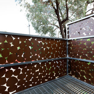 Inspiration for a small contemporary brown two-story metal exterior home remodel in Melbourne