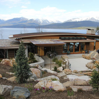 Example of a trendy wood exterior home design in Vancouver
