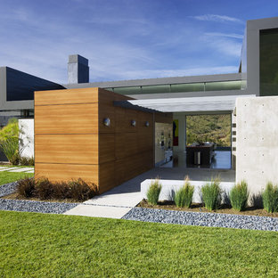 Large modern gray two-story concrete flat roof idea in Los Angeles