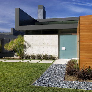 Inspiration for a large modern gray two-story concrete flat roof remodel in Los Angeles