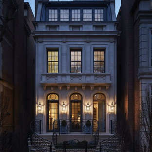 Example of a huge classic beige three-story stone flat roof design in Chicago