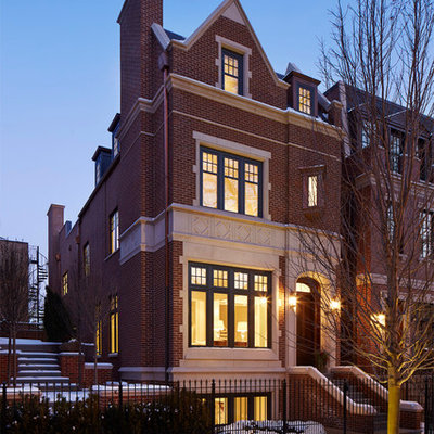 Inspiration for a large timeless brown three-story brick exterior home remodel in Chicago