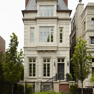 Inspiration for a huge timeless beige three-story townhouse exterior remodel in Chicago