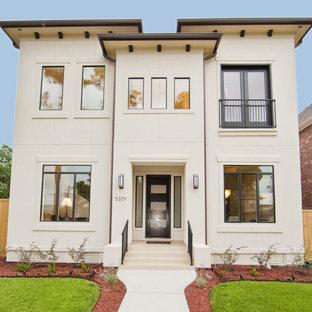 Diseño de fachada beige, actual, de dos plantas, con revestimiento de hormigón y tejado plano
