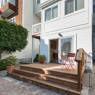 Example of a small minimalist white one-story wood exterior home design in San Francisco