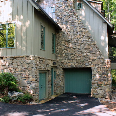 Elegant stone exterior home photo in Other