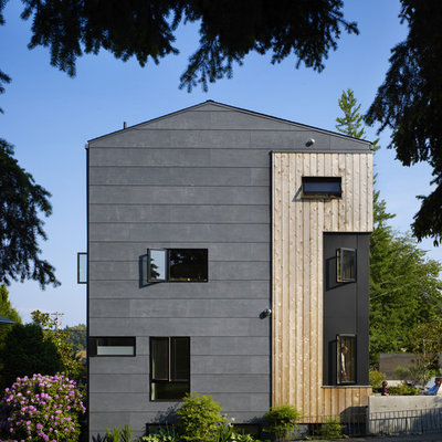 Inspiration for a mid-sized contemporary gray three-story mixed siding gable roof remodel in Seattle