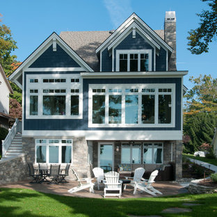 Mid-sized beach style blue three-story concrete fiberboard gable roof idea in Grand Rapids