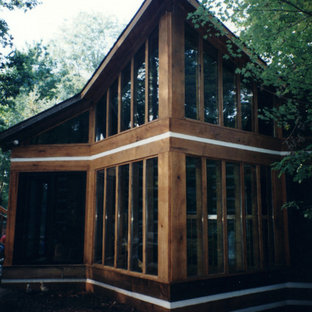 Mid-sized rustic brown two-story wood exterior home idea in Other with a shingle roof