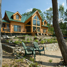 Rustic Exterior by Coventry Log Homes