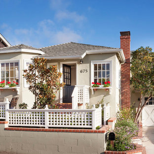 Small coastal beige one-story exterior home photo in Orange County with a hip roof