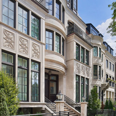 Large elegant beige three-story brick townhouse exterior photo in New Orleans