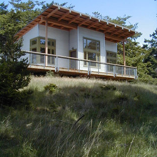 Inspiration for a contemporary metal exterior home remodel in Seattle with a shed roof