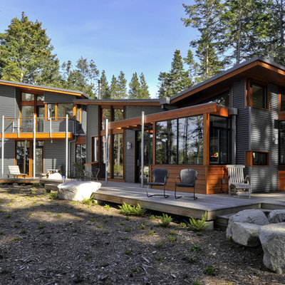 Example of a trendy wood exterior home design in Seattle with a butterfly roof