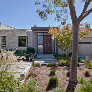 Example of a minimalist stucco exterior home design in San Francisco