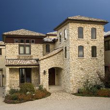 Rustic Exterior by Conrado - Home Builders