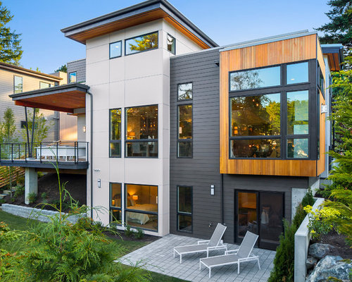 Example Of A Trendy Three Story Mixed Siding Exterior Home Design In Seattle