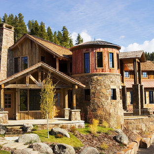 Rustic two-story mixed siding exterior home idea in Other
