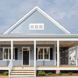 Large country blue two-story concrete fiberboard exterior home photo in Raleigh with a shingle roof